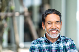 older man smiling because of treatment for low testosterone in Richardson