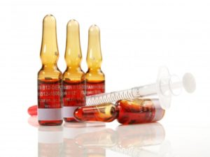 Vitamin B12 vials and needle