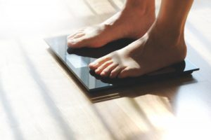 feet on scale seeing weight loss in Richardson