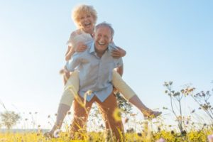 older couple smiling and being active