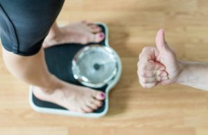 thumbs up from a weight loss coach